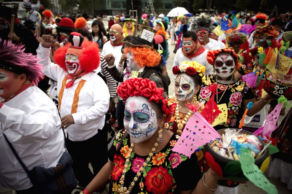 Clowns take part in the 20th International Clowns Convention in Mexico City, capital of Mexico, on Oct. 21, 2015. During the convention that is being held here ...