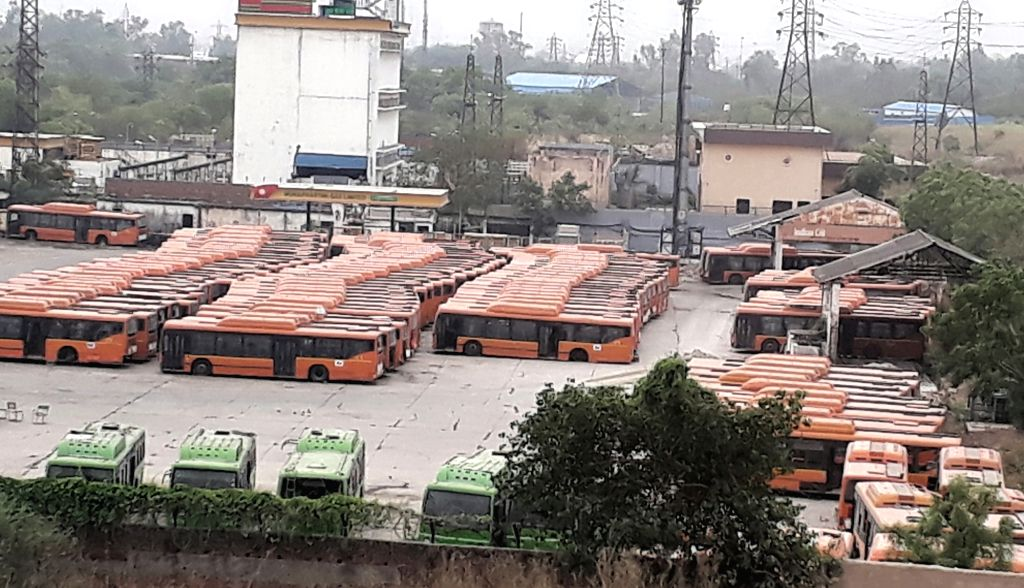 Cluster busses remain parked in a depot as drivers and conductors go on an indefinite strike alleging non-payment of their salaries as per the new rates of minimum wages, in New Delhi on ...