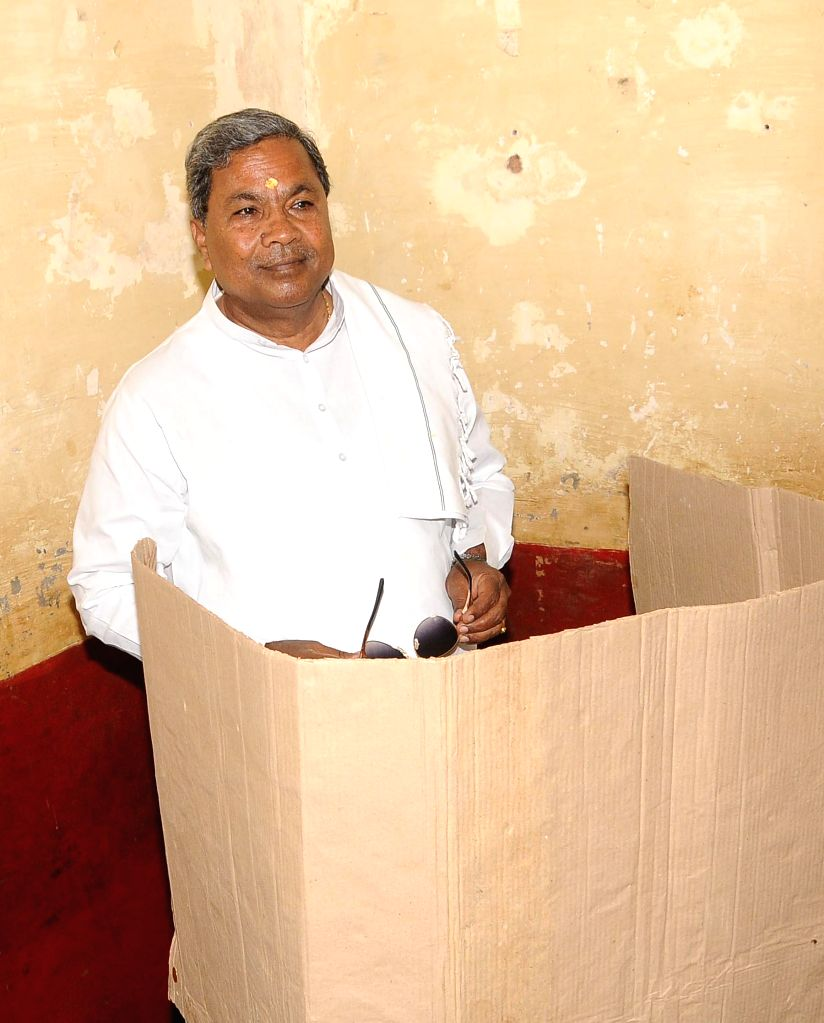 CM Siddaramaiah cast his vote for Loksabha elections 2014, in Mysore on April 17, 2014.