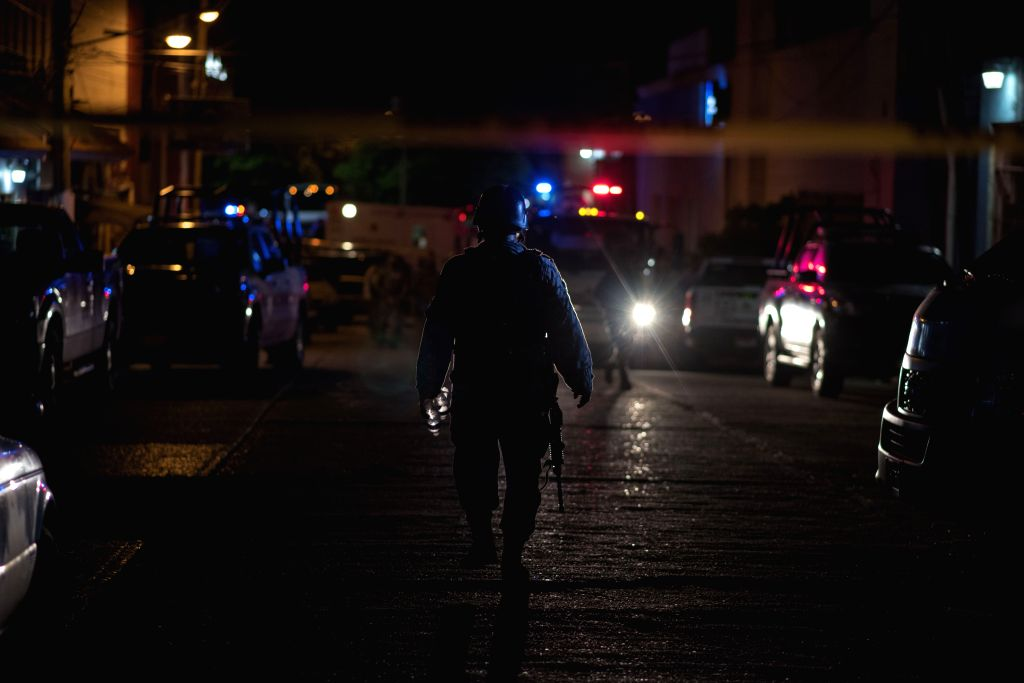 COATZACOALCOS, Aug. 28, 2019 (Xinhua) -- A security member patrols near a nightclub in Coatzacoalcos, Mexico, Aug. 27, 2019. A total of 23 people were killed and some 10 others seriously injured when a nightclub in eastern Mexico was set on fire Tues