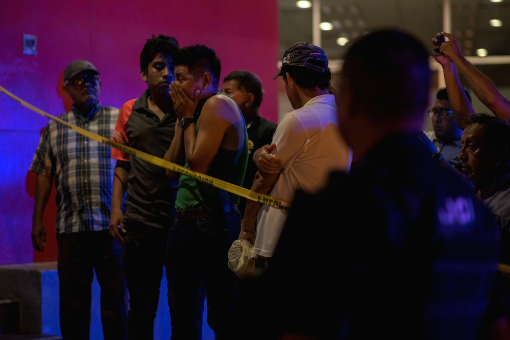 COATZACOALCOS, Aug. 28, 2019 (Xinhua) -- People gather near a nightclub waiting for information in Coatzacoalcos, Mexico, Aug. 27, 2019. A total of 23 people were killed and some 10 others seriously injured when a nightclub in eastern Mexico was set