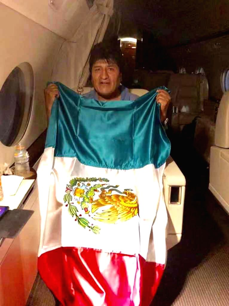 COCHABAMBA, Nov. 12, 2019 - Image provided by the Mexican Foreign Ministry taken with a mobile device shows Evo Morales holding a Mexican national flag aboard an airplane of the Mexican Air Force, in ...