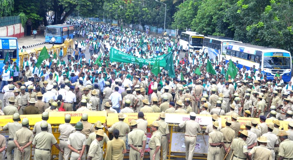 Coconut and Arecanut farmers particiapte in a rally to press for various demands in Bengaluru, on June 25, 2016.