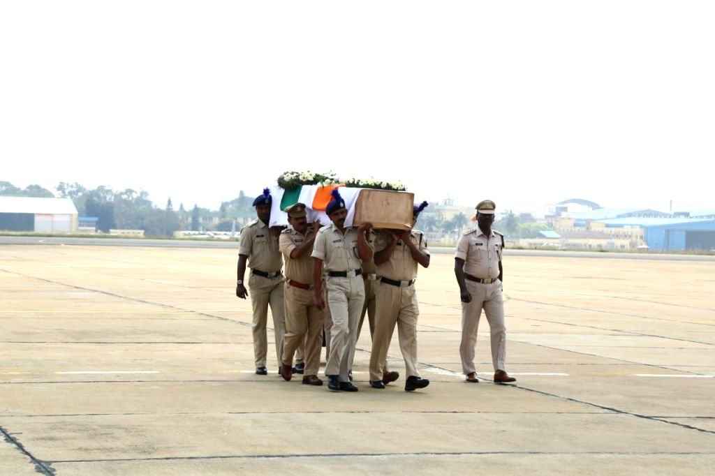 Coffin of Guru H, who was among the 45 CRPF personnel killed 14 Feb Pulwama militant attack arrives in Bengaluru on Feb 16, 2019.