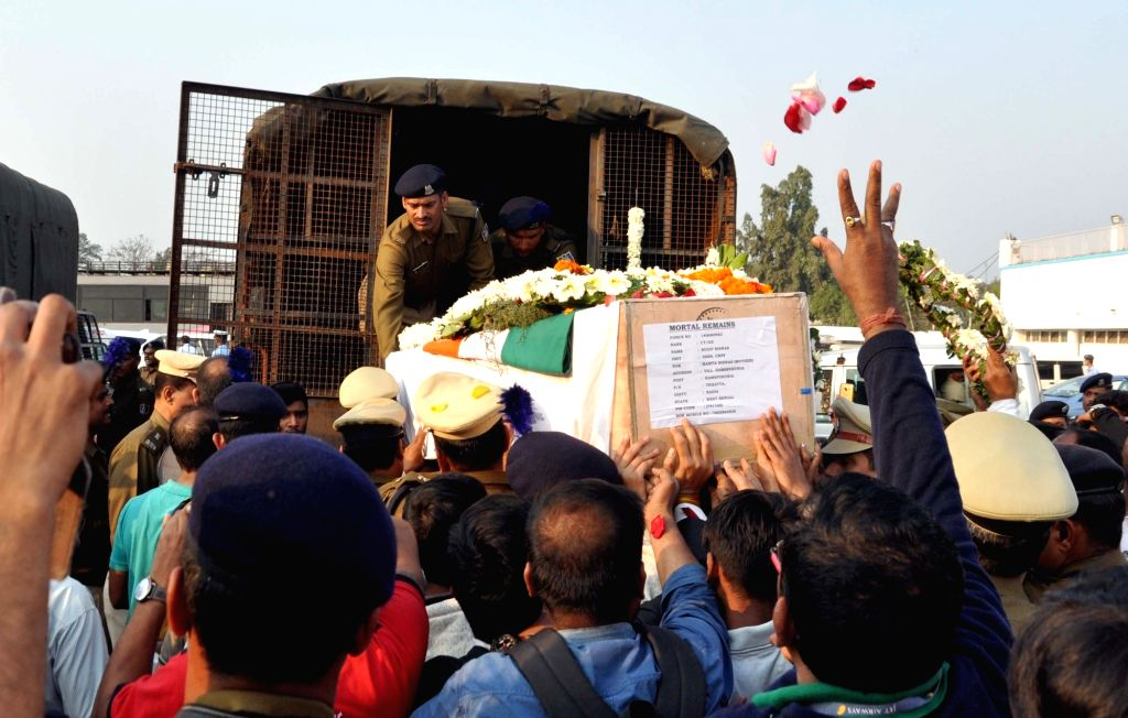 Coffin of martyr Sudip Biswas, being loaded to be taken to his native place, in Kolkata on Feb 16, 2019.