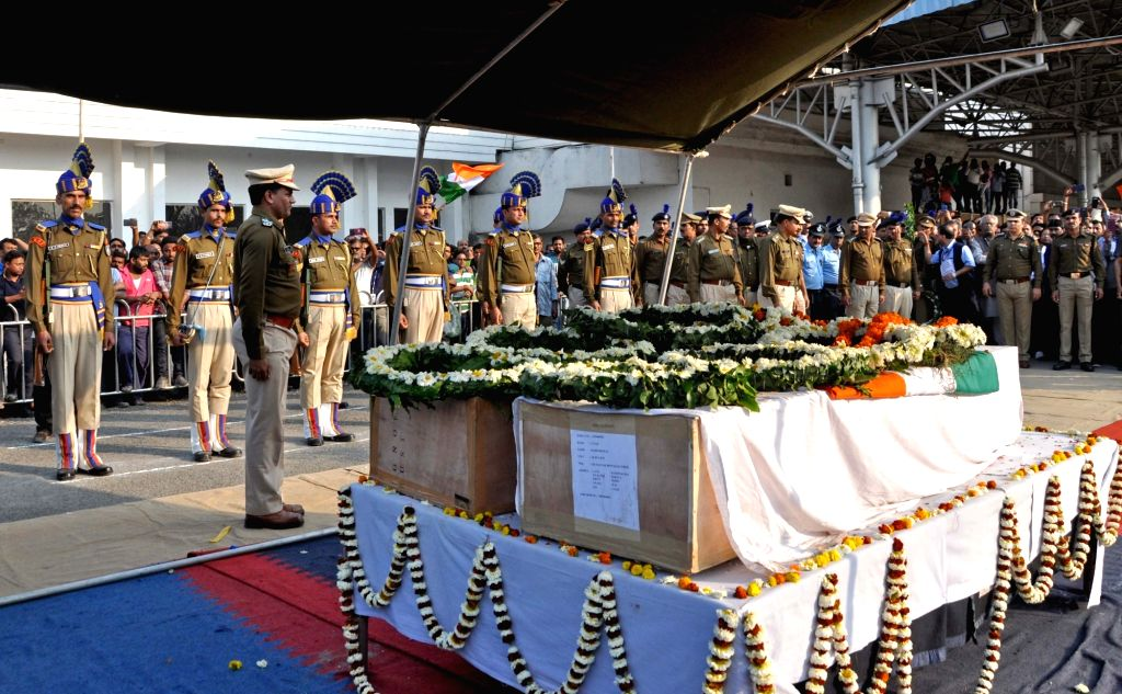 Coffins of martyrs Bablu Santra and Sudip Biswaws, who were among the 49 CRPF men killed in 14 Feb Pulwama militant attack arrive at Netaji Subhas Chandra Bose International Airport in ...