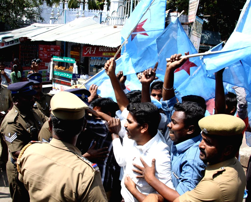 Police detain Tamil Tiger activists during a protest against the visit of Sri Lankan President Mahinda Rajapaksa to India in Coimbatore onFeb. 7.