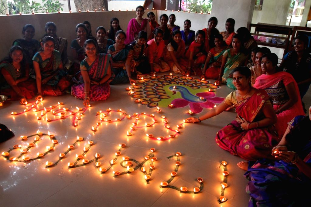 College students celebrate Diwali in Chennai on Oct 28, 2016.
