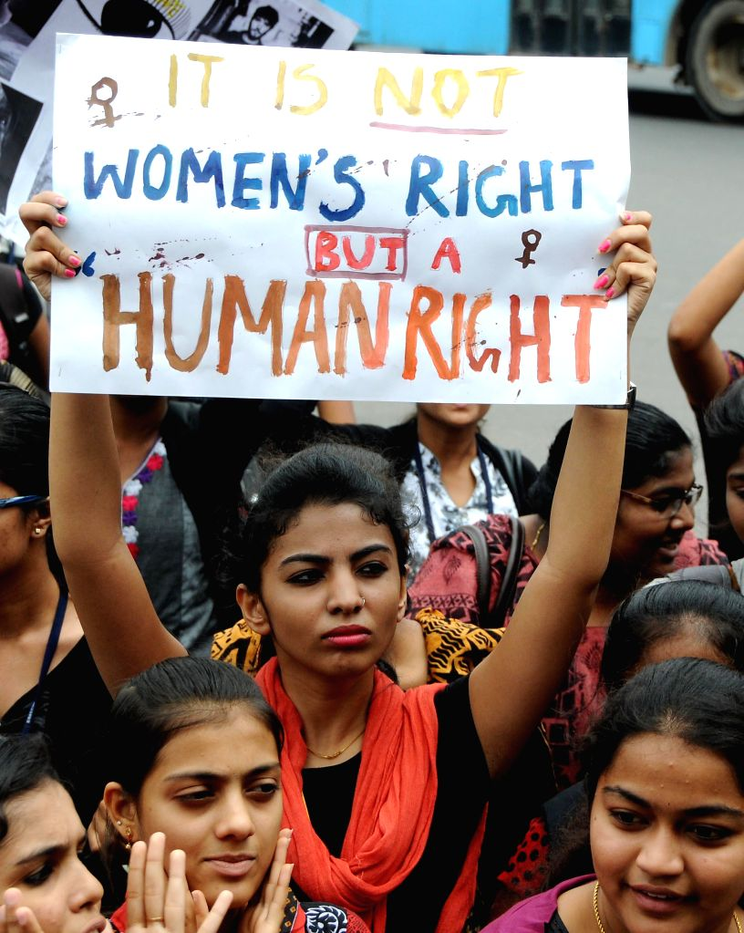 College students demonstrate against crime against women in Bangalore on July 22, 2014.