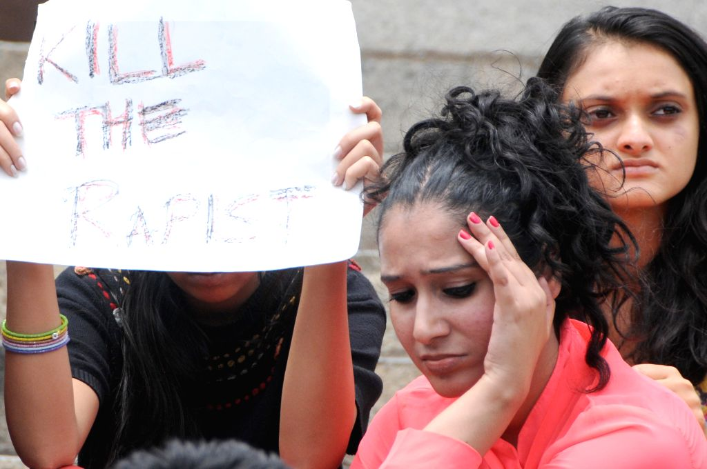 College students participate in a demonstration against crimes against women in Bangalore on July 21, 2014.