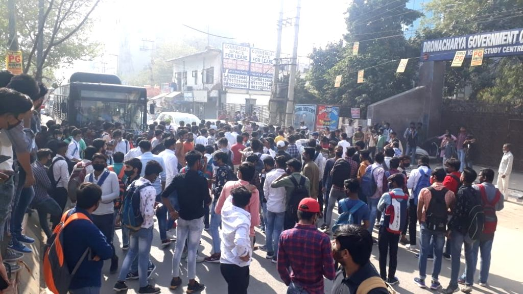 College students protest, block road, boycott classes demanding online examination