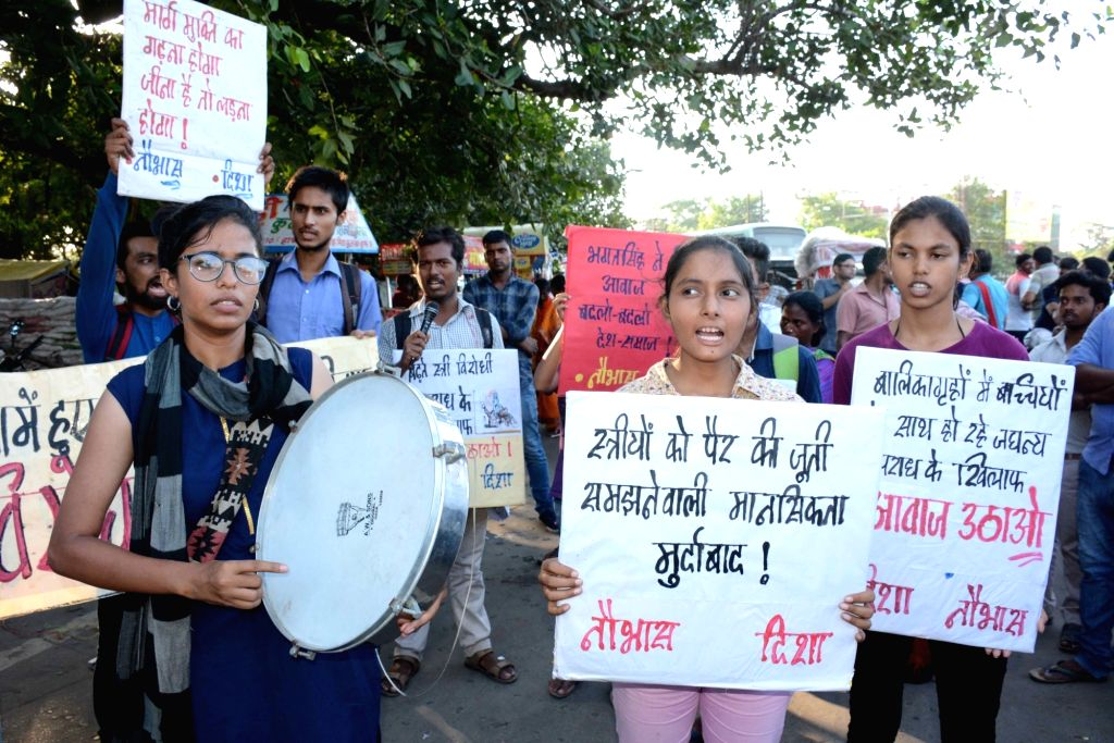 College students stage a demonstration against Muzaffarpur shelter home rapes, in Patna on Aug 9, 2018.