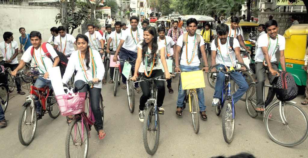 Colleges students participate in a cycle rally organised to create awareness regarding ill effects of plastic in Bangalore on Aug 11, 2014.