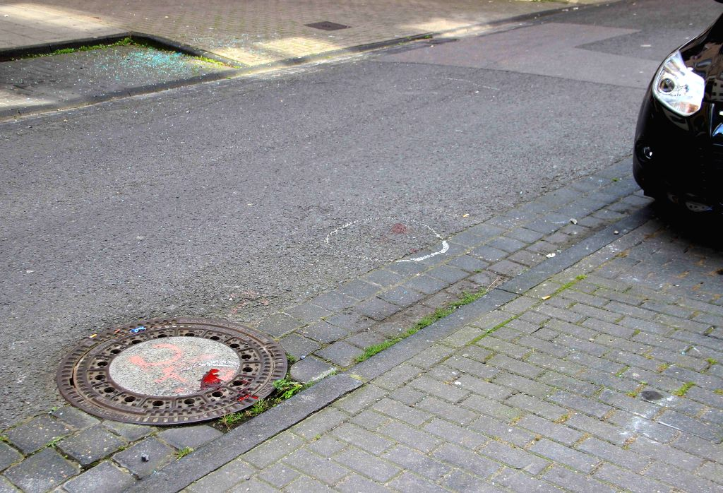 COLOGNE, Aug. 15, 2016 - Photo taken on Aug. 15, 2016 shows the bloodstain at the site of attack in Cologne, Germany. At least one man was seriously injured in a knife and shooting attack in Cologne, ...