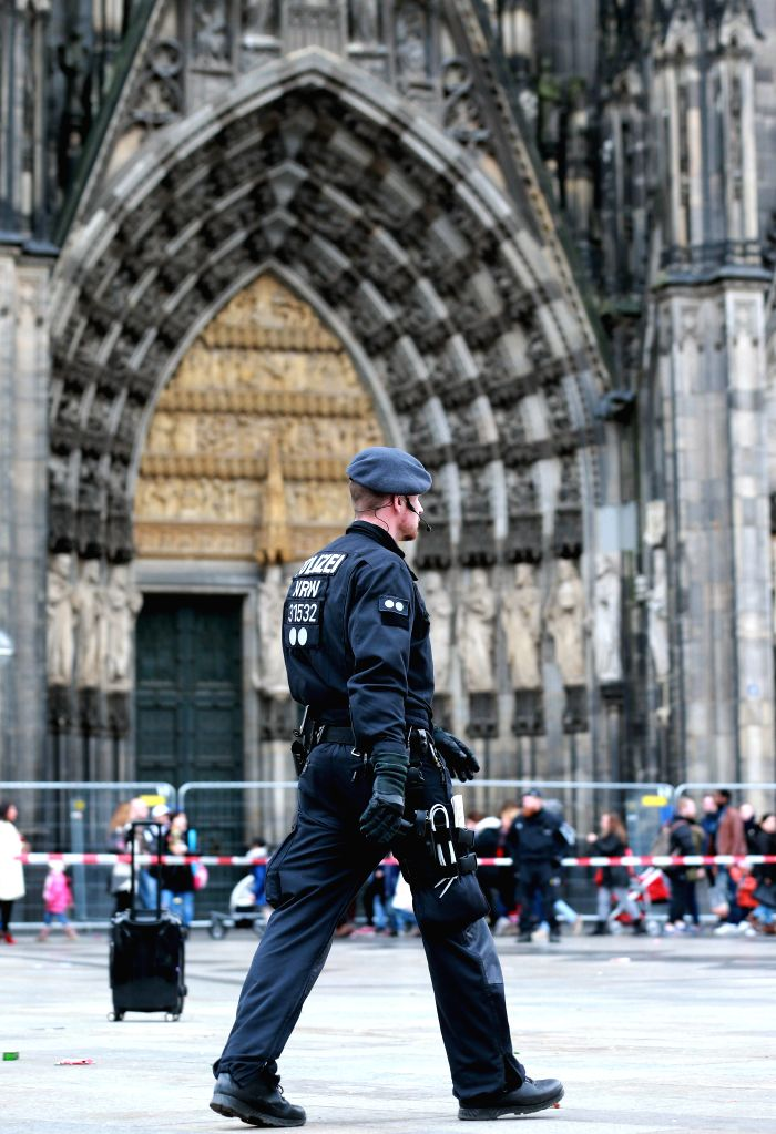 COLOGNE, Feb. 26, 2017 - A German policeman patrols at the square which links Cologne Cathedral and Cologne's main railway station after a suspicious black draw-bar box was found in Cologne, Germany ...