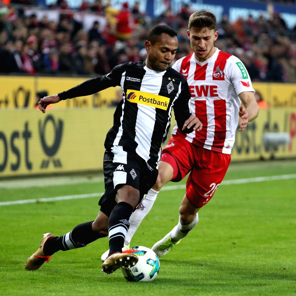 COLOGNE, Jan. 15, 2018 - Raffael (L) of Borussia Moenchengladbach vies with Salih Ozcan of 1.FC Koeln during the Bundesliga match between 1. FC Koeln and Borussia Moenchengladbach in Cologne, ...