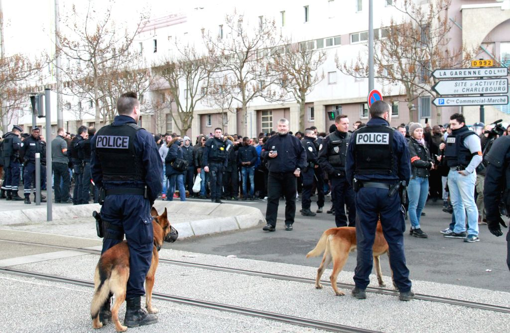 Policemen stand guard in Colombes, France, on Jan. 16, 2015. The armed man who took two hostages at noon time on Friday in a post office at Colombes in the west of