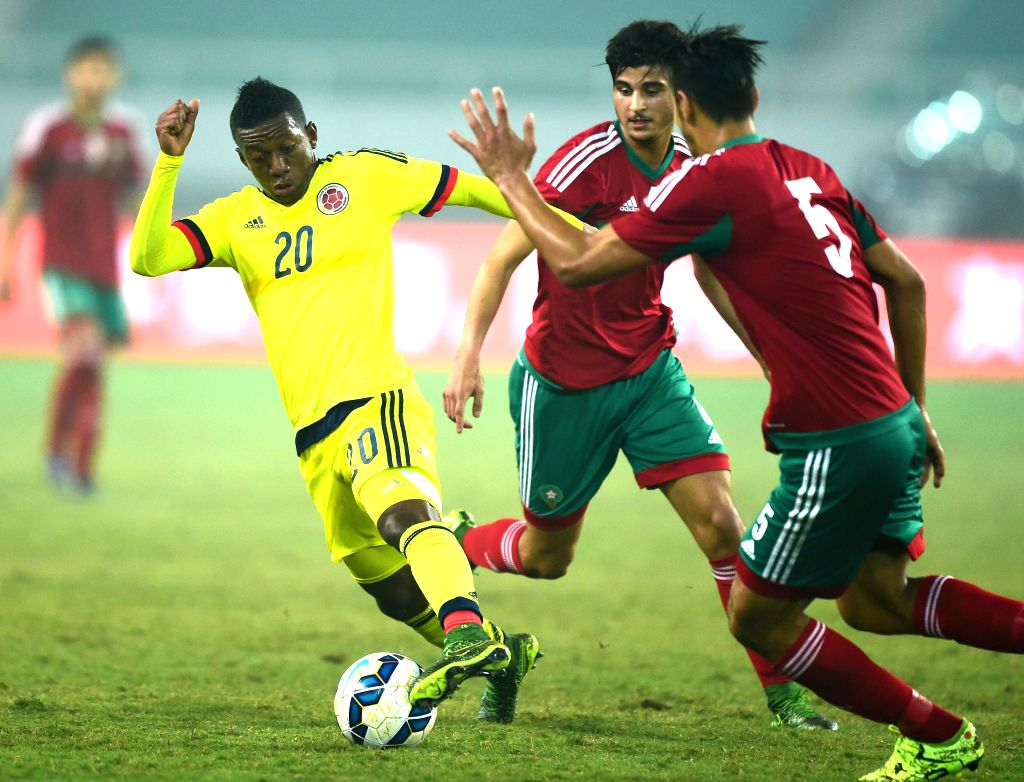 Colombia's Brayan Angulo (L) competes during the 2015 Wuhan U23 International Football Tournament between Colombia and Morocoo in Wuhan, central China's Hubei ...