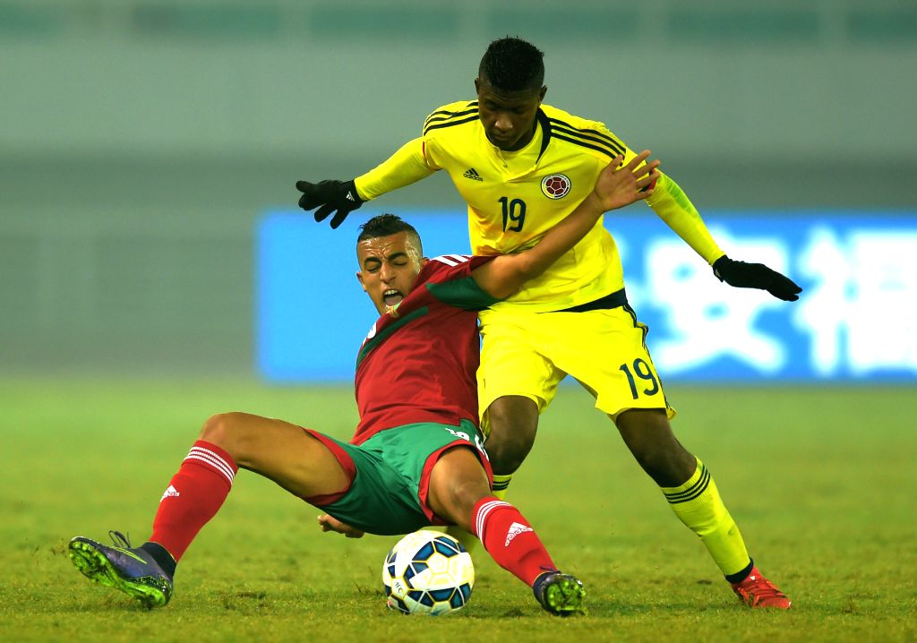 Colombia's Luis Orejuela (R) vies with Morocco's Aziz Ghrib during the 2015 Wuhan U23 International Football Tournament between Colombia and Morocoo in Wuhan, central ...