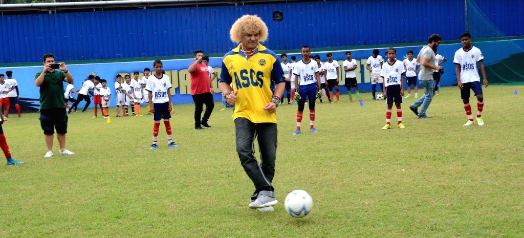 Colombian footballer Carlos Alberto Valderrama with young footballer during a visit to a football academy in Kolkata on Sep 9, 2017.
