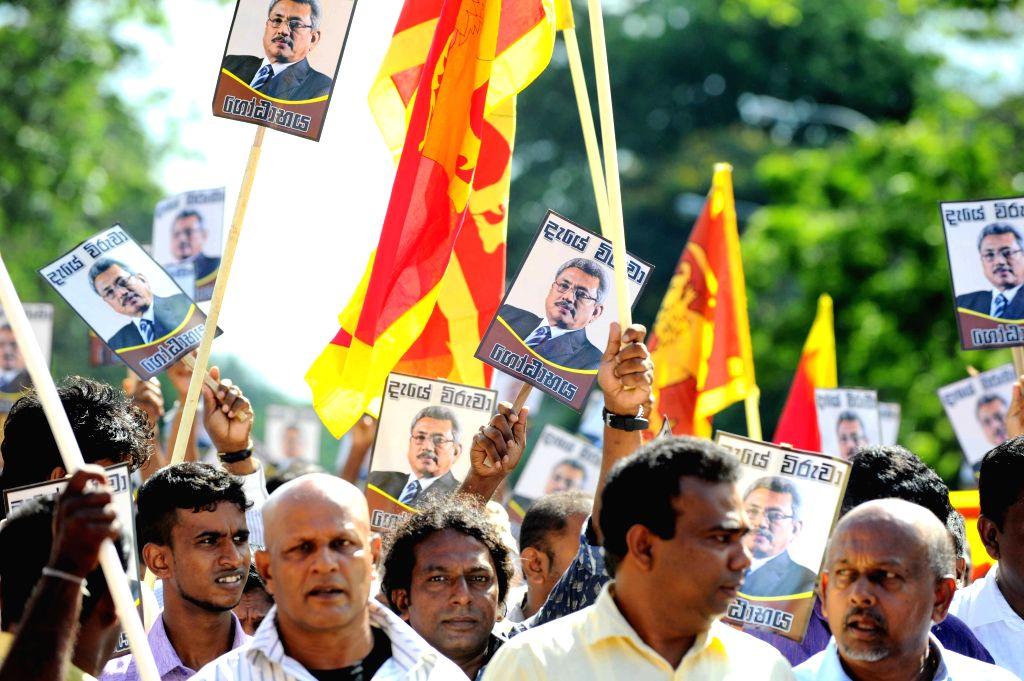 Supporters of Sri Lankan former Defense Secretary Gotabaya Rajapakse protest against the anti-graft commission in Colombo, capital of Sri Lanka, on April 23, 2015. ...