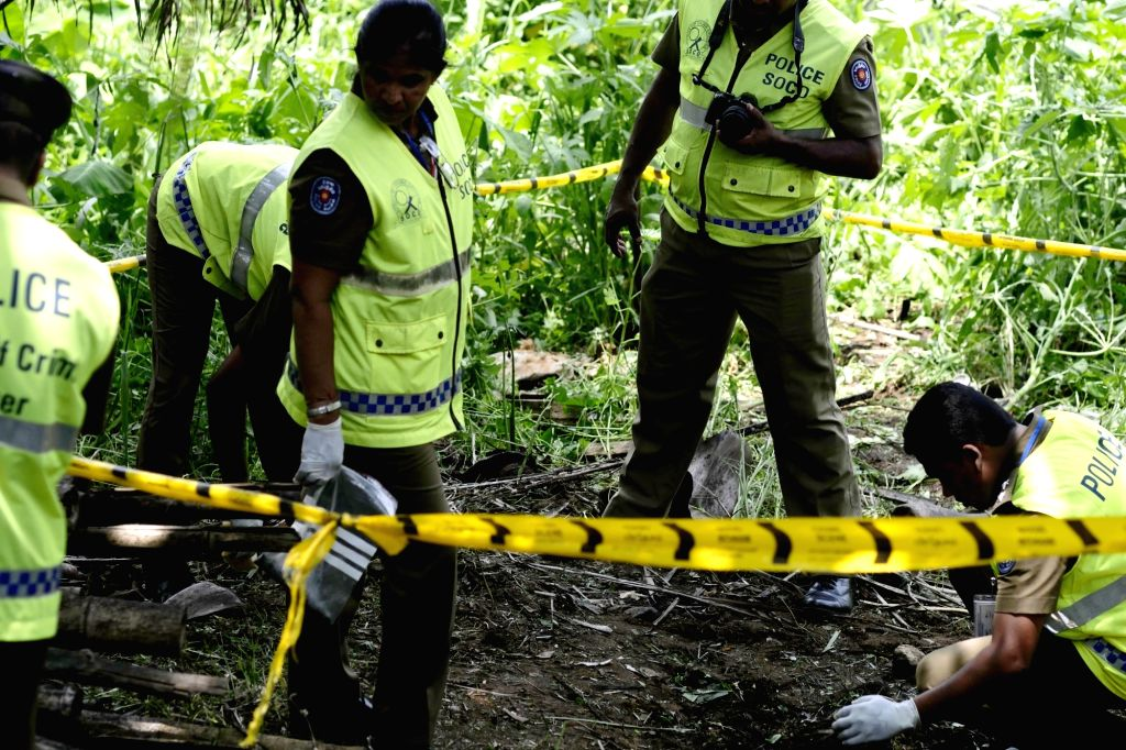 Colombo, April 25, 2019 - Police officers work at the explosion site in Pugoda on the east outskirts of Sri Lankan capital Colombo April 25, 2019. A minor explosion hit a garbage dump in Pugoda on ...