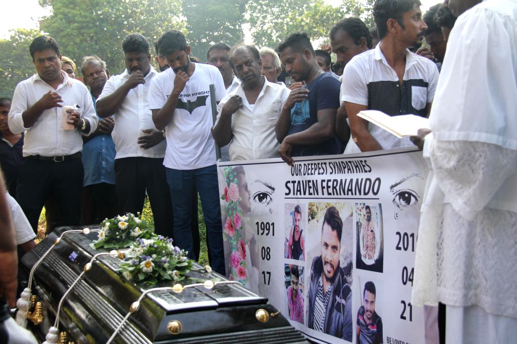 COLOMBO, April 25, 2019 - Relatives and friends mourn for a blast victim at the Madampitiya Cemetery in Colombo, Sri Lanka, on April 24, 2019. Days after the deadly blasts that hit churches, hotels ...