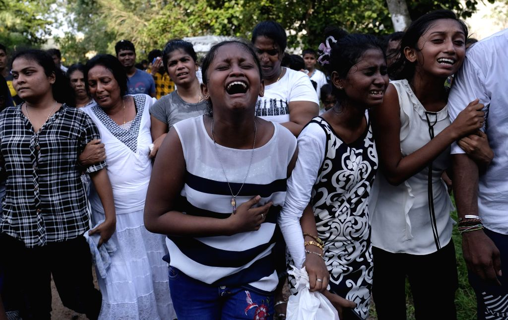 COLOMBO, April 25, 2019 (Xinhua) -- Relatives and friends mourn for a blast victim at the Madampitiya Cemetery in Colombo, Sri Lanka, on April 24, 2019. Days after the deadly blasts that hit churches, hotels in Sri Lanka Sunday, families, friends of