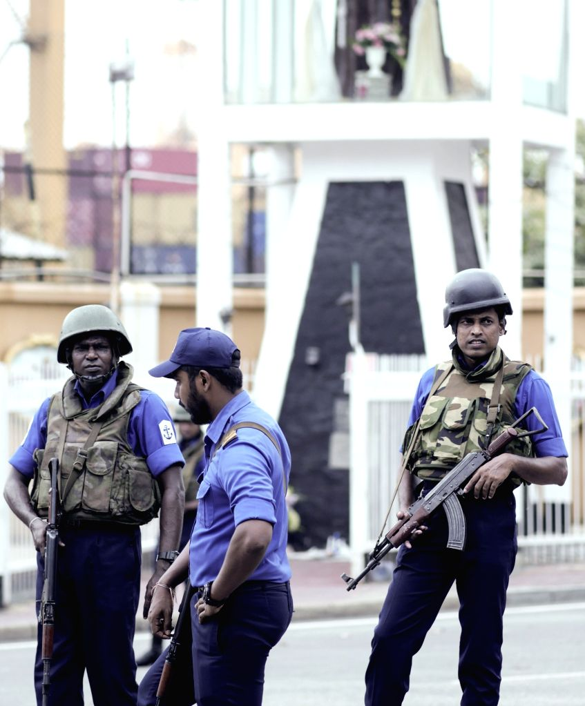 COLOMBO, April 26, 2019 - Policemen stand guard in Colombo, Sri Lanka, April 26, 2019. Sri Lanka on Thursday revised the death toll from multiple terror attacks on Sunday to around 253 from 359, Sri ...