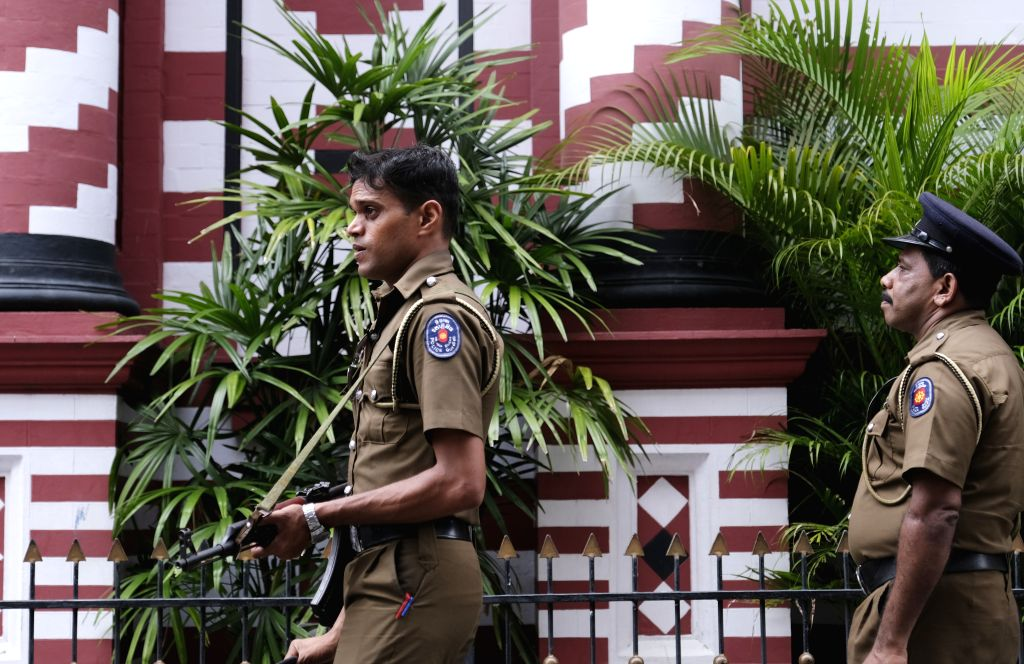 COLOMBO, April 26, 2019 (Xinhua) -- Policemen guard in Colombo, Sri Lanka, April 26, 2019. Sri Lanka on Thursday revised the death toll from multiple terror attacks on Sunday to around 253 from 359, Sri Lanka's Health Ministry said on Thursday. (Xinh