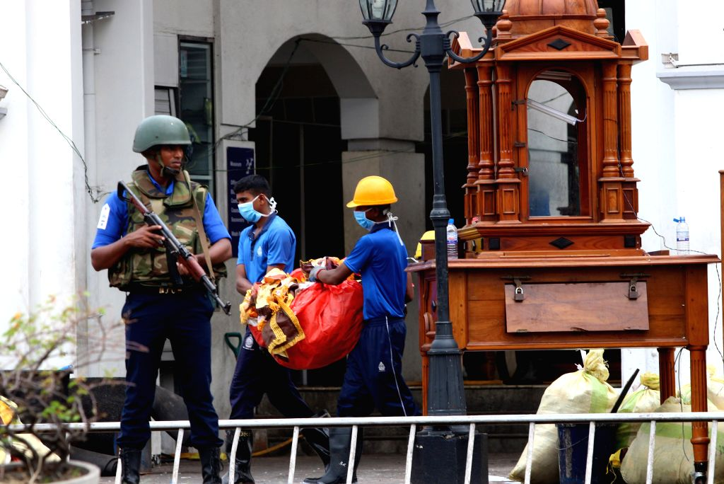 COLOMBO, April 27, 2019 - Workers clear away debris and shattered glass amid tight security outside St. Anthony's Church, one of the targets in a series of bomb blasts targeting churches and luxury ...