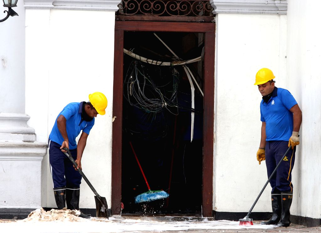 COLOMBO, April 27, 2019 - Workers clear away debris and shattered glass outside St. Anthony's Church, one of the targets in a series of bomb blasts targeting churches and luxury hotels on Sunday in ...