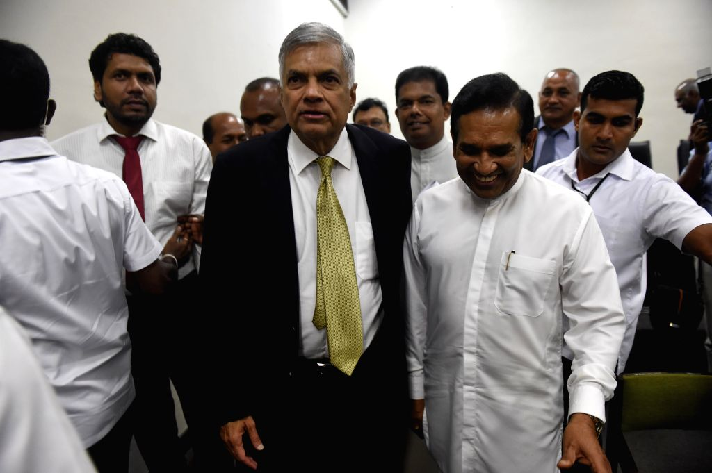 COLOMBO, April 5, 2018 - Sri Lankan Prime Minister Ranil Wickremesinghe (C) leaves the Parliament after the debate of no confidence against him, in Colombo, Sri Lanka on April 4, 2018. Sri Lankan ... - Ranil Wickremesingh