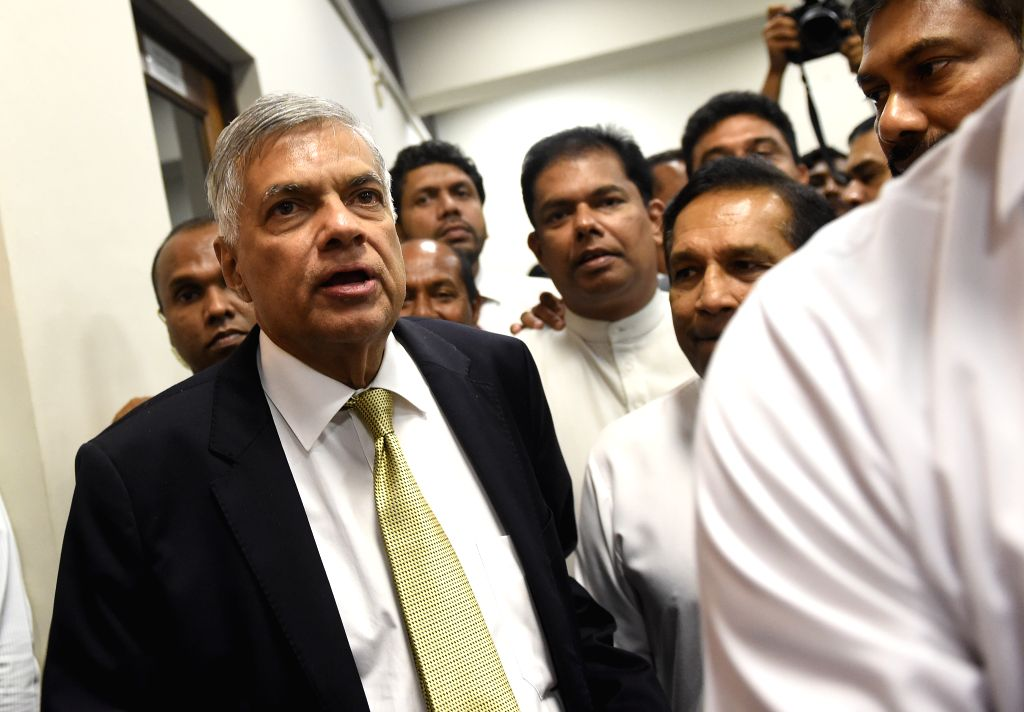 COLOMBO, April 5, 2018 - Sri Lankan Prime Minister Ranil Wickremesinghe (L, front) leaves the Parliament after the debate of no confidence against him, in Colombo, Sri Lanka on April 4, 2018. Sri ... - Ranil Wickremesingh
