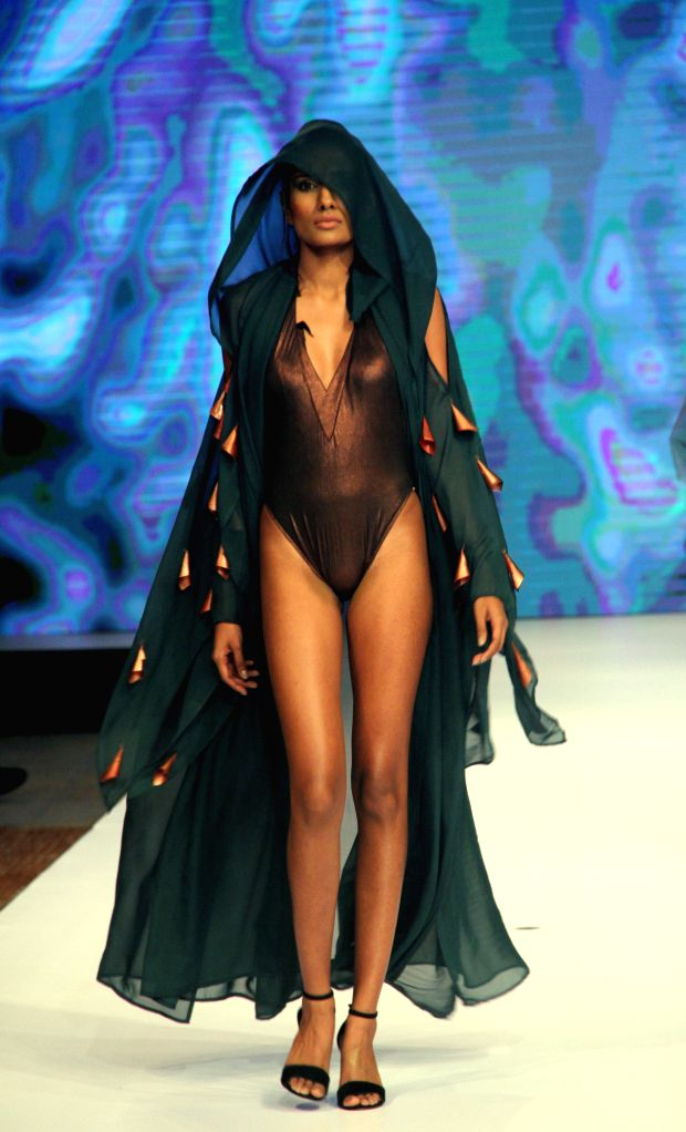 COLOMBO, Aug. 11, 2019 - A model presents a creation at the Olu Swim Week in Colombo, Sri Lanka, on Aug. 10, 2019. Swimwear and resort wear collections were showcased during the fashion week here.