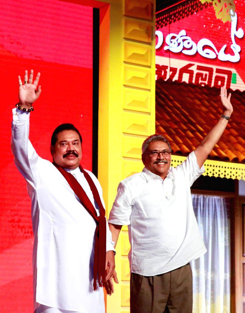 COLOMBO, Aug. 11, 2019 - Photo taken on Aug. 11, 2019 shows Sri Lanka's opposition leader Mahinda Rajapaksa (L) and his brother, former defense secretary Gotabaya Rajapaksa, at a Sri Lanka Podujana ...