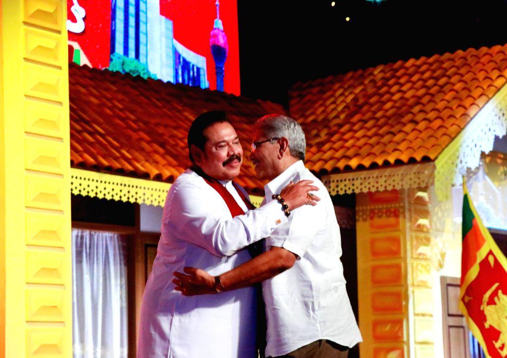 COLOMBO, Aug. 11, 2019 - Sri Lanka's opposition leader Mahinda Rajapaksa (L) hugs his brother, former defense secretary Gotabaya Rajapaksa, at a Sri Lanka Podujana Peramuna (SLPP) party conference ...