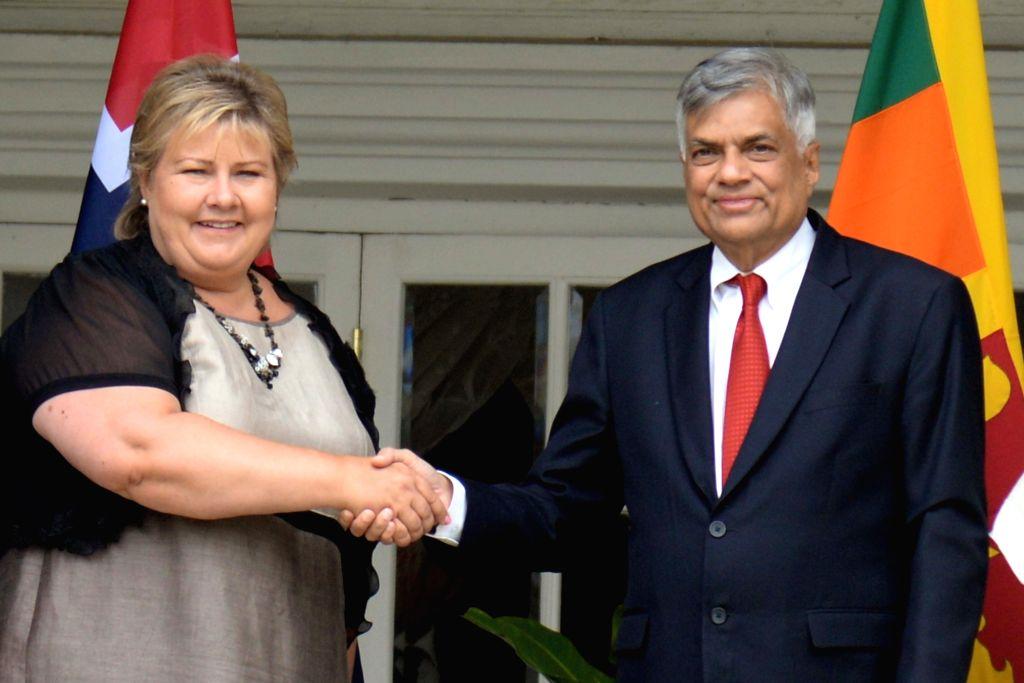 COLOMBO, Aug. 12, 2016 - Visiting Norway's Prime Minister Erna Solberg (L) shakes hands with Sri Lankan Prime Minister Ranil Wickremasinghe in Colombo, capital of Sri Lanka, Aug. 12, 2016. Sri Lanka ... - Erna Solberg