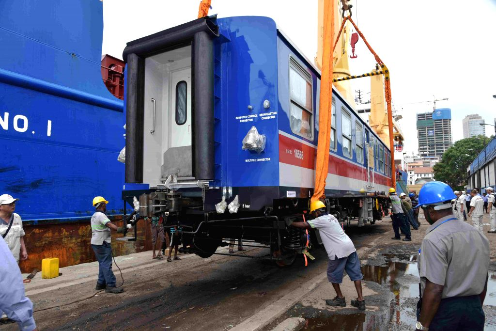 COLOMBO, Aug. 13, 2019 - Workers unload one of the carriages of an imported Chinese-made train at Colombo port in Sri Lanka, Aug. 13, 2019. Sri Lanka has imported a train from China for its upcountry ...