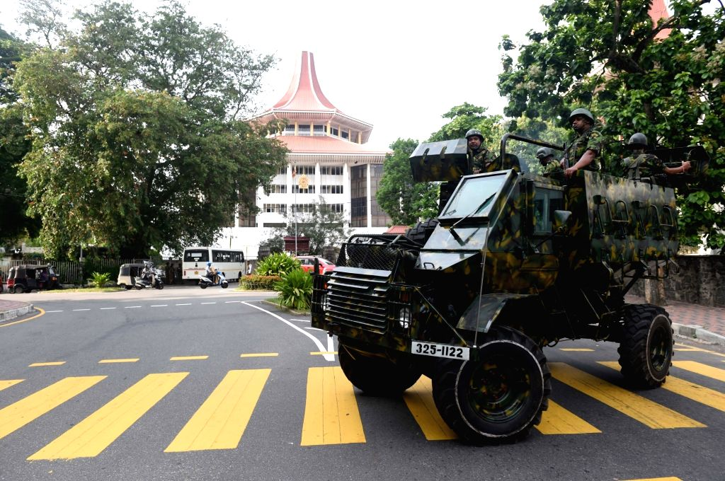 COLOMBO, Dec. 13, 2018 - Soldiers patrol along a road near the Supreme Court in Colombo, Sri Lanka, on Dec. 13, 2018. Sri Lankan Supreme Court on Thursday ruled against President Maithripala ...