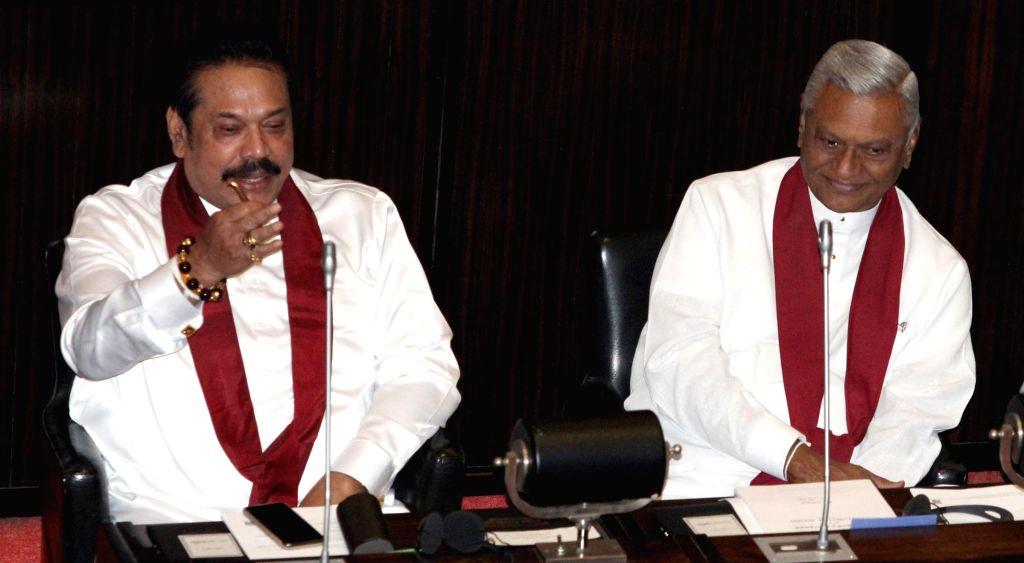 COLOMBO, Dec. 18, 2018 (Xinhua) -- Sri Lankan former President Mahinda Rajapaksa (L) attends a parliament session in Colombo, Sri Lanka, on Dec. 18, 2018. Sri Lankan former President Mahinda Rajapaksa who resigned from the prime ministerial position  - Karu Jayasuriya