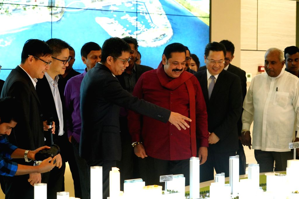 COLOMBO, Dec. 7, 2019 - Sri Lankan Prime Minister Mahinda Rajapaksa (3rd R, Front) visits the Colombo Port City along with Chinese Ambassador to Sri Lanka Cheng Xueyuan (2nd R, Front) in Colombo, Sri ... - Mahinda Rajapaksa