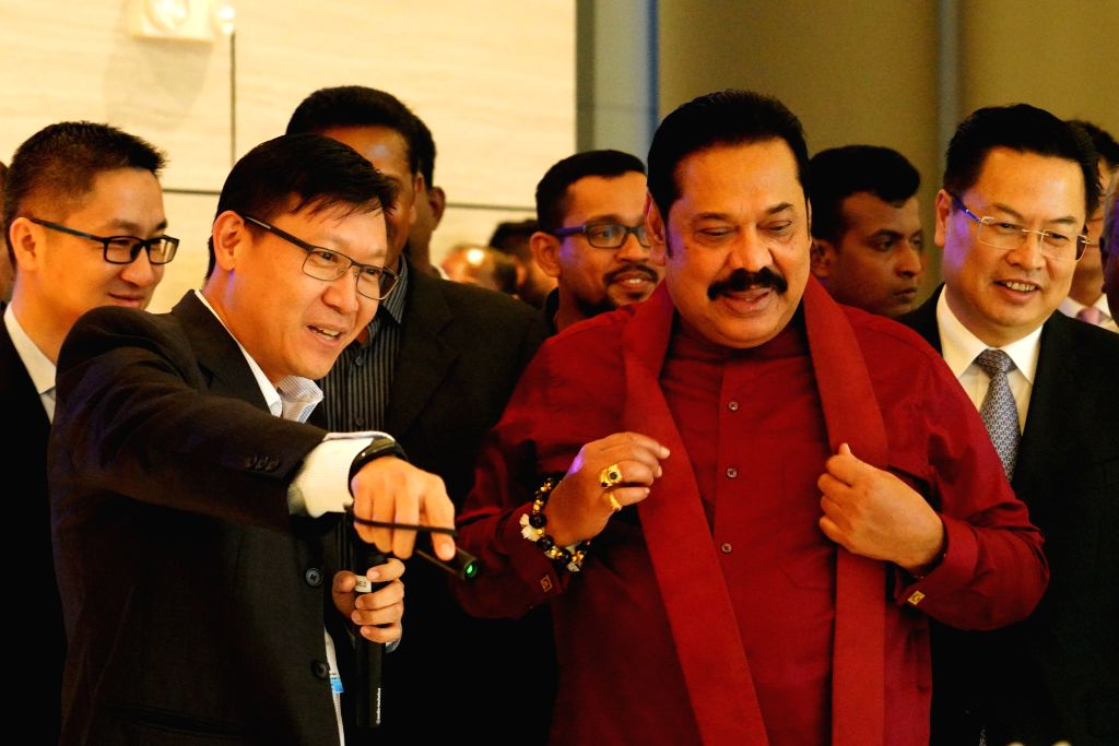 COLOMBO, Dec. 7, 2019 - Sri Lankan Prime Minister Mahinda Rajapaksa (2nd R, Front) visits the Colombo Port City along with Chinese Ambassador to Sri Lanka Cheng Xueyuan (1st R, Front) in Colombo, Sri ... - Mahinda Rajapaksa