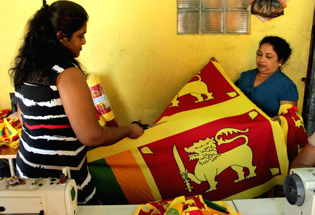 COLOMBO, Feb. 1, 2019 - Tailors make national flags at a small shop in Colombo, Sri Lanka, on Jan. 31, 2019. Sri Lanka will celebrate its 71st Independence Day on Feb. 4.