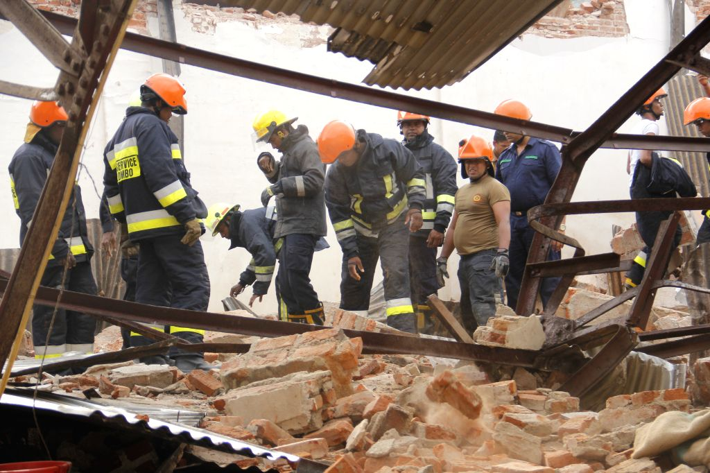COLOMBO, Feb. 14, 2018 - Members of the rescue team work at the site of the collapsed warehouse in Colombo, Sri Lanka, on Feb. 14, 2018. At least seven people were killed and two others critically ...