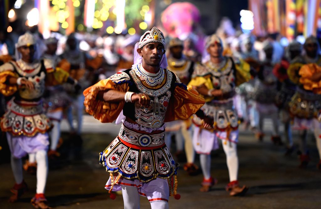 COLOMBO, Feb. 19, 2019 - Sri Lankan traditional Kandyan dancers perform in front of the Gangarama Temple in Colombo, Sri Lanka, on Feb. 18, 2019. Thousands of people with dozens of elephants gathered ...