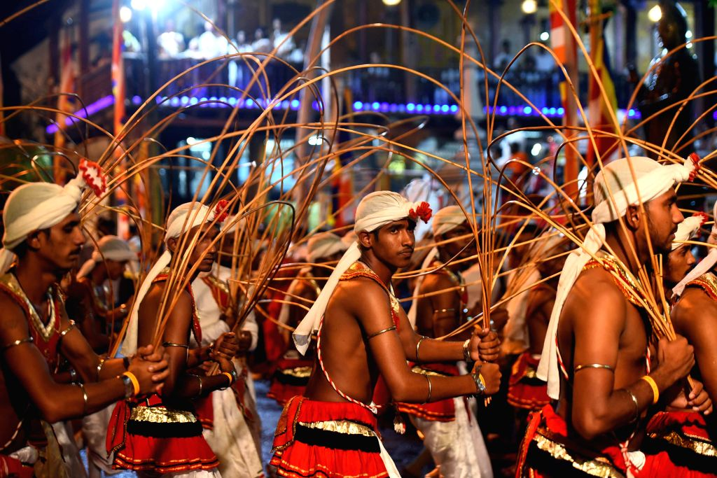 COLOMBO, Feb. 20, 2019 - Sri Lankan traditional Kandyan dancers perform in front of the Gangaramaya Temple in Colombo, Sri Lanka, on Feb. 19, 2019. Thousands of people with dozens of elephants ...