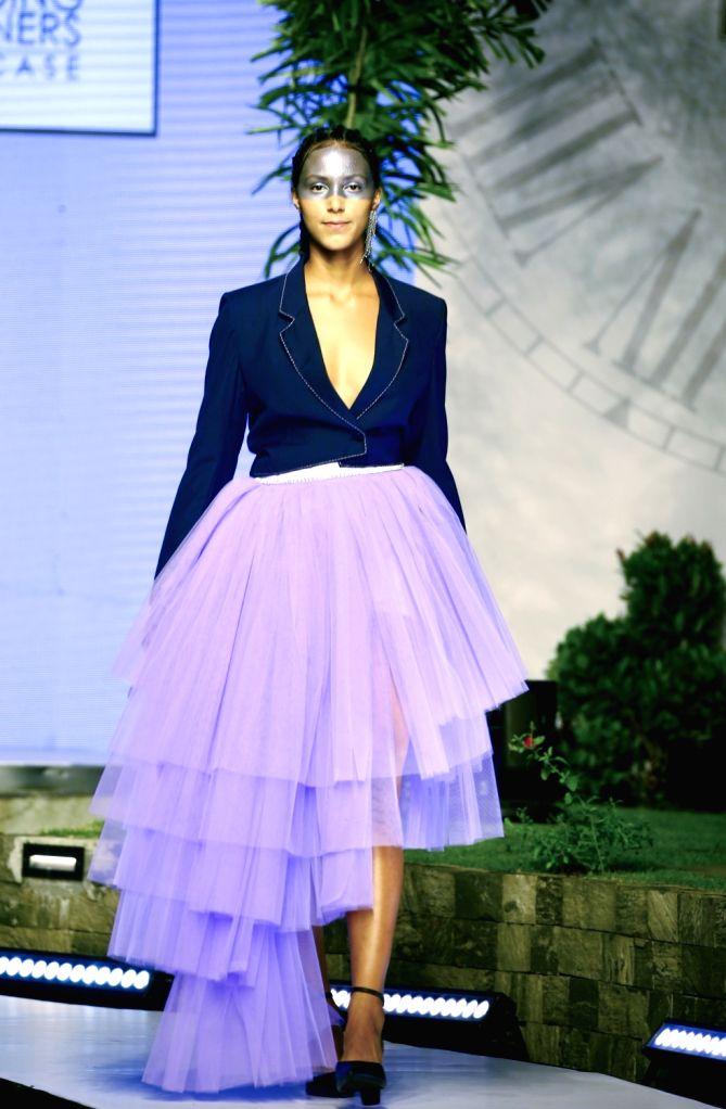 COLOMBO, Feb. 28, 2019 - A model presents a creation at the annual Colombo Fashion Week in Colombo, Sri Lanka, Feb. 27, 2019.