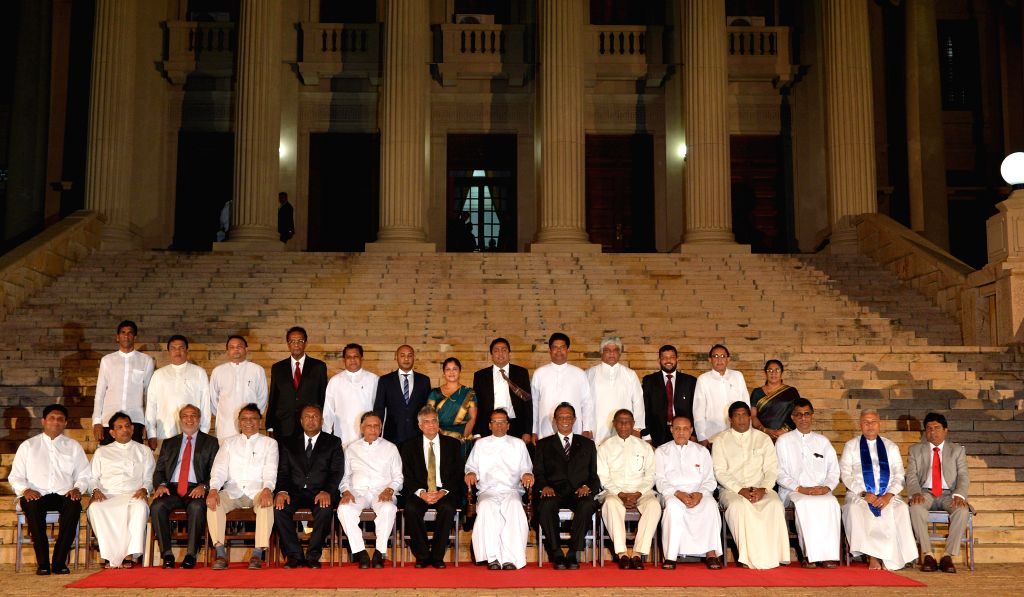 Members of new Cabinet pose for family photos after swearing-in in Colombo, capital of Sri Lanka, Jan. 12, 2015. Sri Lanka's newly-elected President Maithripala ...