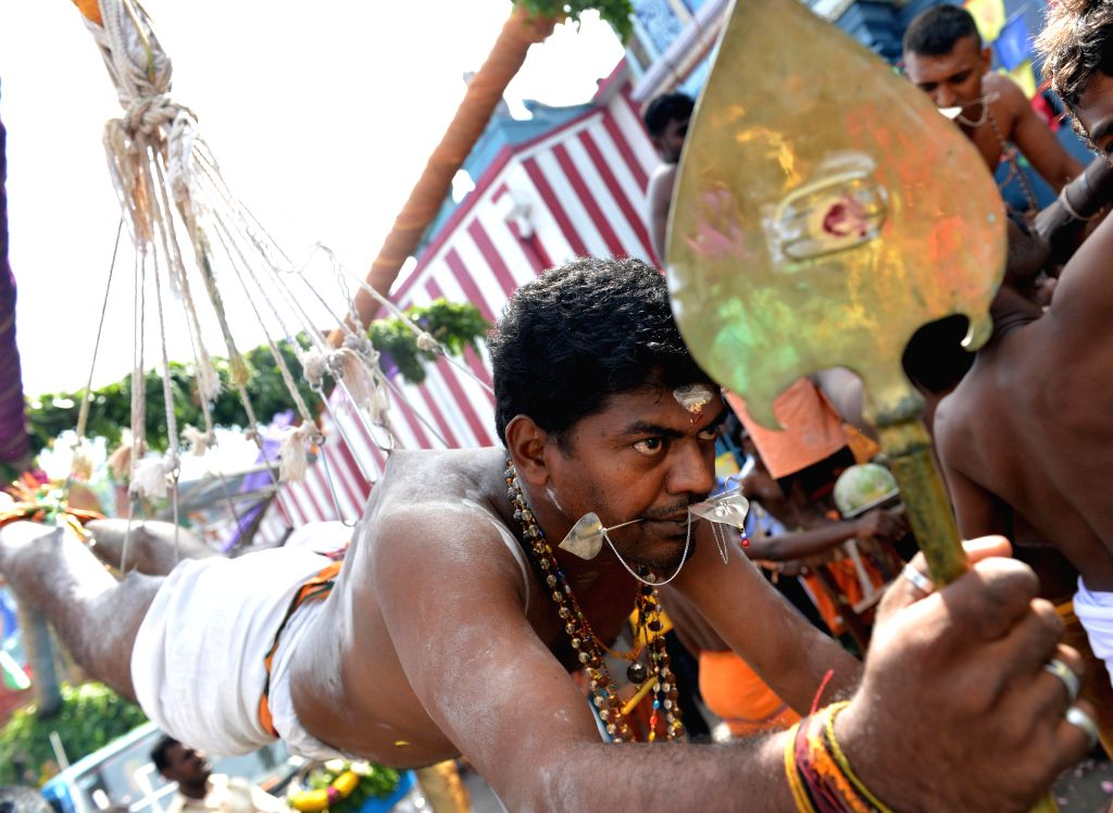 A Sri Lankan Tamil Hindu devotee, seen suspended with hooks pierced through his body, participates in the Vel Hinduism festival celebration in Colombo, on July 21, .